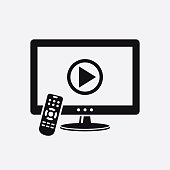 istock TV with remote control and play button on screen icon 1205798231