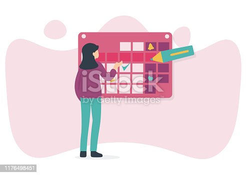 A young woman marks the date of menstruation in the online calendar. An app for tracking your menstrual cycle and birth control.