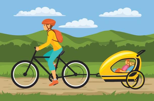 frau und ihren kindern reisen, radfahren zusammen. mutter schleppt fahrrad trolley mit glückliche kinder - landstraße stock-grafiken, -clipart, -cartoons und -symbole