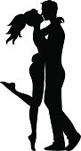 Silhouette of couple. Woman and man kissing
