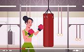 woman blogger hitting huge punching bag sportswoman boxer vlogger recording online video for blog healthy lifestyle live streaming concept modern boxing studio interior horizontal portrait vector illustration