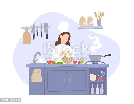istock Woman Cook Prepares Salad in the Kitchen 1289089020