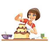 istock Woman decorates a Cake 1218736367