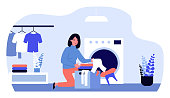 Woman doing laundry. Female character loading washing machine flat vector illustration. Laundromat, home appliance, housekeeping concept for banner, website design or landing web page