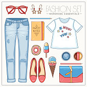Woman fashion summer set with t shirt, clutch and jeans