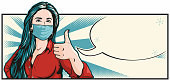 Pop art illustration of a beautiful young woman wearing a protective surgical face mask, giving the thumbs up. Letterbox format with empty speech bubble for your text.