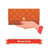 Woman hand holding luxury leather purse
