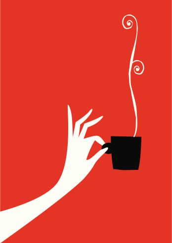 Woman hand with cup of coffee or tea.