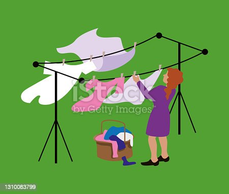 Woman Hanging Up Laundry In The Wind