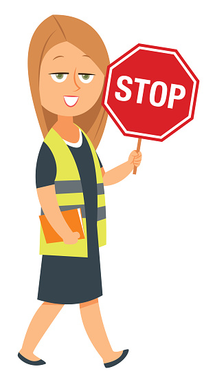 Woman holding a stop sign and wearing a safety vest