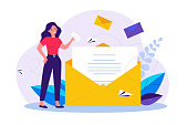 istock Woman holding business message in envelope 1226858848