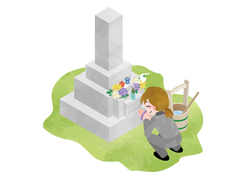 A woman holding hands on a grave (visiting a Japanese grave)