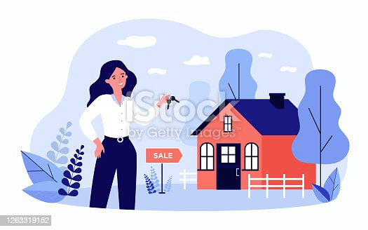 istock Woman holding keys from house for sale and smiling 1263319152