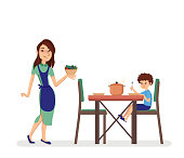 Woman holding plate with food. Boy sitting at the Dinner table in the kitchen. Isolated Cartoon style vector illustration