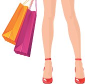 istock Woman holding shopping bags 166008505