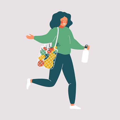 Woman holds reusable cup and eco bag with fresh food