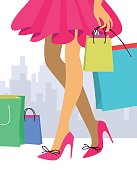 Woman in a red skirt and high heel shoes with shopping bags. Concept of sale.