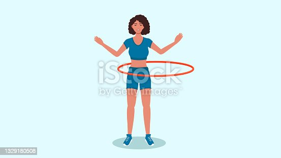 A woman in a tank top and shorts twirls a hoop .