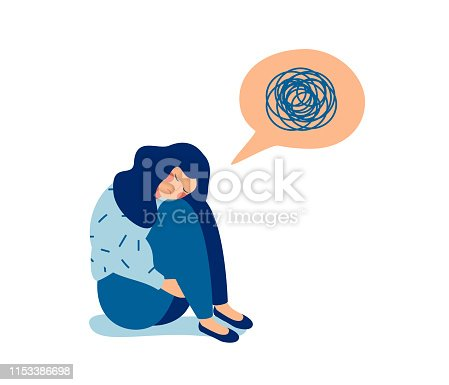 Woman in depression with bewildered thoughts in her mind. Young sad girl sitting and unhappy hugging her knees.