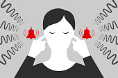 istock Woman is plugging her ears with fingers when suffering from tinnitus 1213070078