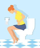 Woman is sitting on the toilet. urinary bladder problem or sickness concept. stomach-ache woman