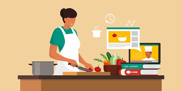 Woman learning recipes online
