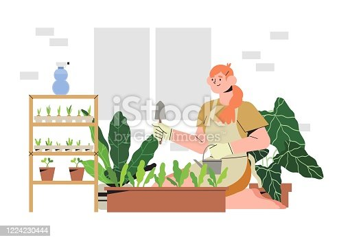 istock Woman on a balcony or patio growing plants or vegetables in a flowerpot, planting and watering seeds. Concept of urban home gardening or indoor vegitables farming. Seedling in a paper containers. 1224230444