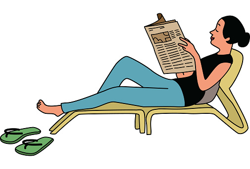 Woman on a deck chair reading