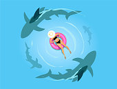 istock Woman on the inflatable ring with sharks 1096985920