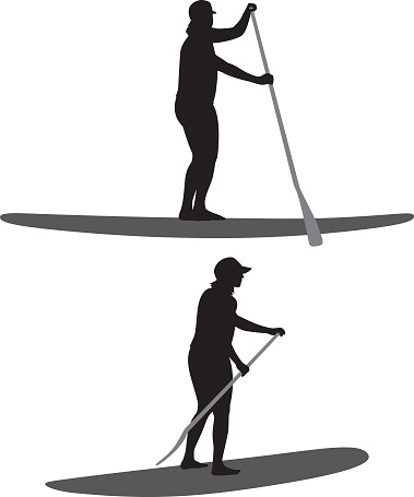 Woman Paddle Boarding Silhouettes