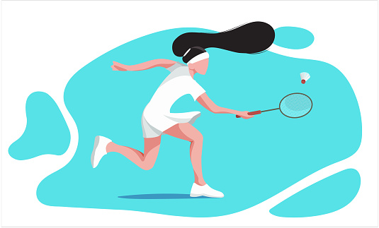 woman playing badminton on a court. Badminton rackets and shuttlecock. Sportsmen at the badminton tournament. A racquet sport played outdoors