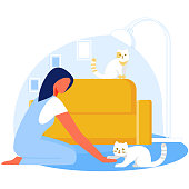 Woman Playing with Cat Flat Cartoon Vector Illustration. Girl Sitting on Floor near Sofa, Cute Fluffy Pets. Female Character Relaxing at Home, Spending Time with Domestic Animals in Living Room.