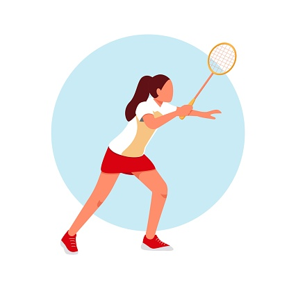 A woman plays badminton on the court.