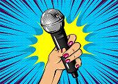 Woman pop art hand hold microphone