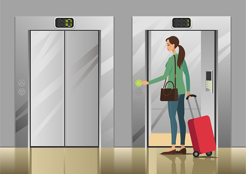 Woman pushing elevator button