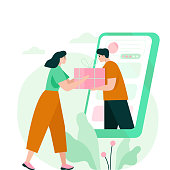 istock Woman receiving a gift box from smartphone. 1213640629