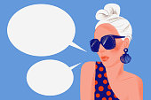 Girl says. Portrait of stylish woman with sunglasses and blank dialog speech bubbles isolated on blue background. Pose. Flat trendy illustration.