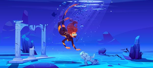 Woman scuba diver and sunken ancient city in sea