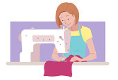 Woman working in a sewing machine