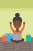 An african-american woman with hands up using laptop for shopping online. Customer sitting with shopping bags around him. Woman doing online shopping. Vector flat design illustration. Vertical layout.