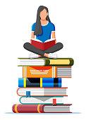 Woman sitting cross-legged on stack of books