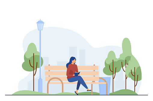 Woman sitting on bench and reading book