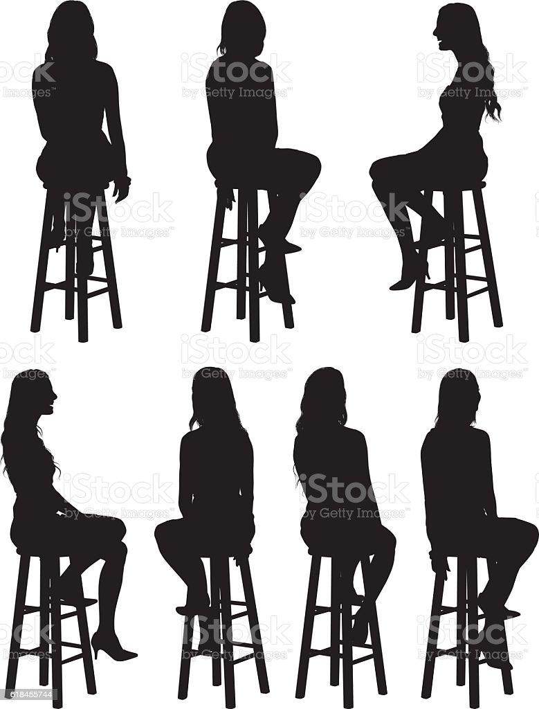 Woman sitting on stool vector art illustration
