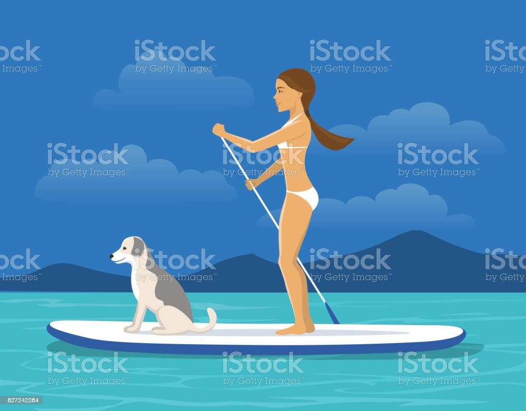 Woman Stand Up Paddling with her Dog