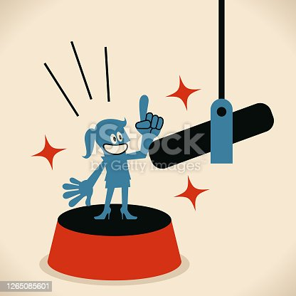 istock Woman talking with a big microphone, giving a presentation on stage, broadcasting or podcasting, sound recording 1265085601