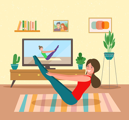 woman training while watching fitness program home workout