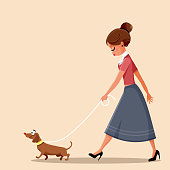 Chic lady in retro style fashion with her cute wiener dog