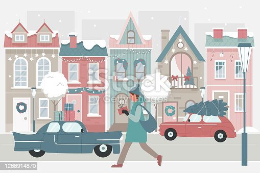 istock Woman walking with Christmas gifts on snow winter street 1288914870