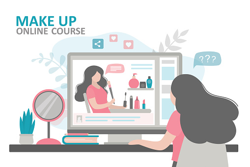 Woman watching lesson from professional makeup artist. Female character learns to use cosmetics through online courses