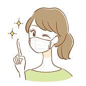 マスクをしてアドバイスをする女性